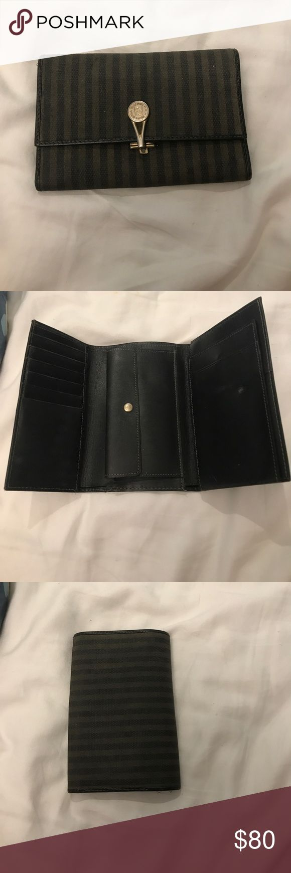 Vintage Fendi wallet A tiny bit worn down but definitely fixable. I love it! Willing to go down in price. Fendi Bags Wallets