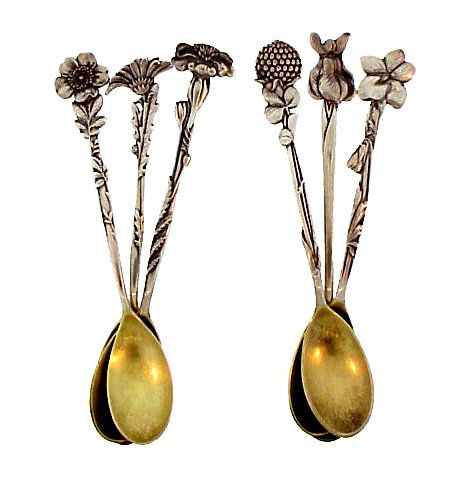 "Set of six sterling silver demitasse spoons in the ""Floral"" pattern by Tiffany & Co. This lovely Victorian spoons feature a different old-fashioned flower on each handle. The tip of each handle is the flower blossom, while the neck is fashioned as the plant stem and foliage. The flowers represented are marigold, clover, daisy, iris, violet, and wild rose."