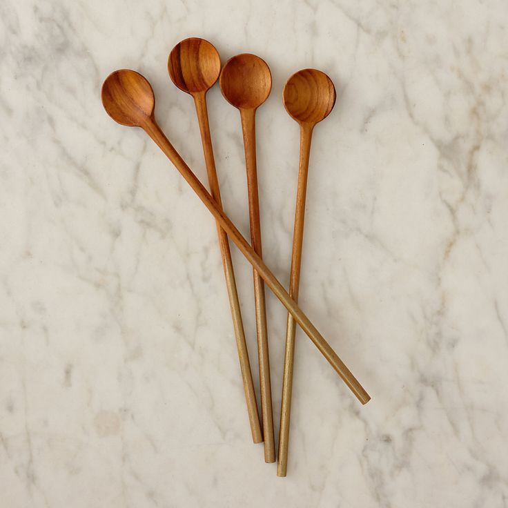 "Warm-hued teak and gold-dipped handles add polish to the hors d'oeuvre table with this set of dainty stirrers.- Set of 4- Teak, gold paint- Hand wash- Imported0.75""W, 6.25""L"