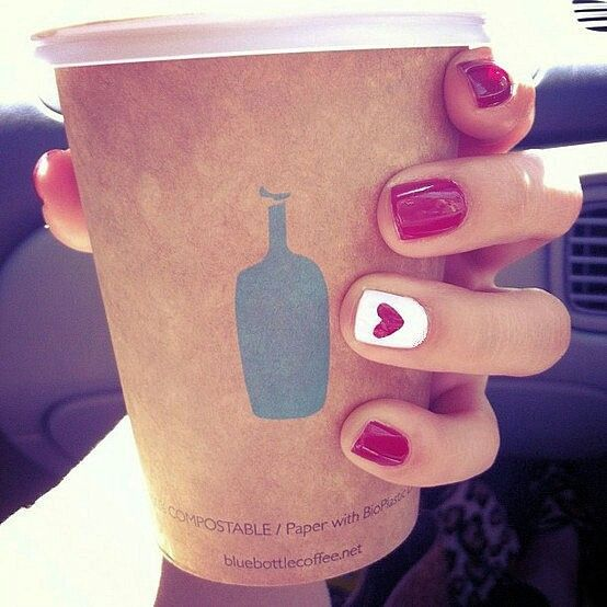 Simple red manicure with white heart accent nail ... Cute for valentines day, or possibly Christmas!
