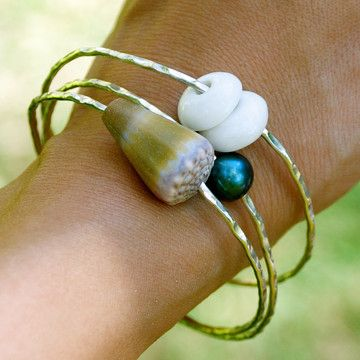 so cute - this girl lives in hawaii and makes jewelry with the shells and other items she finds when she goes diving - love these bangles