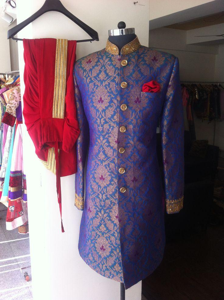 blue sherwani with red dhoti..by SAGAR TENALI