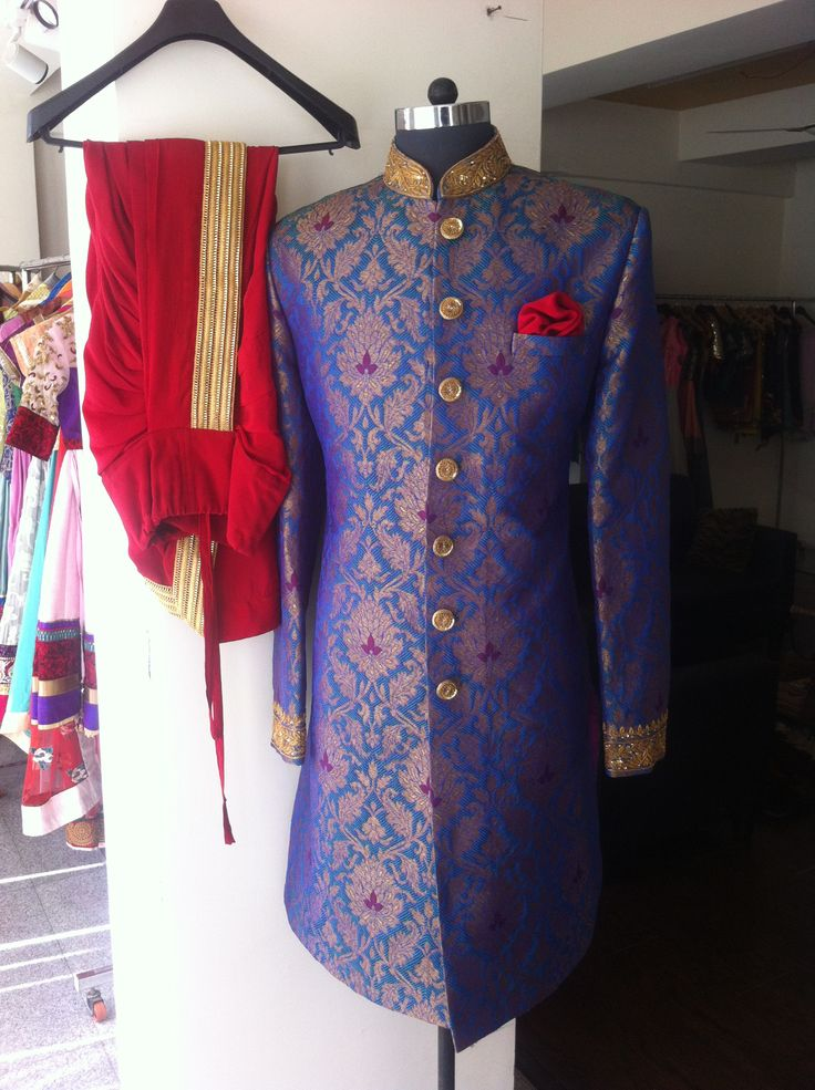 blue sherwani with red dhoti..by SAGAR TENALI