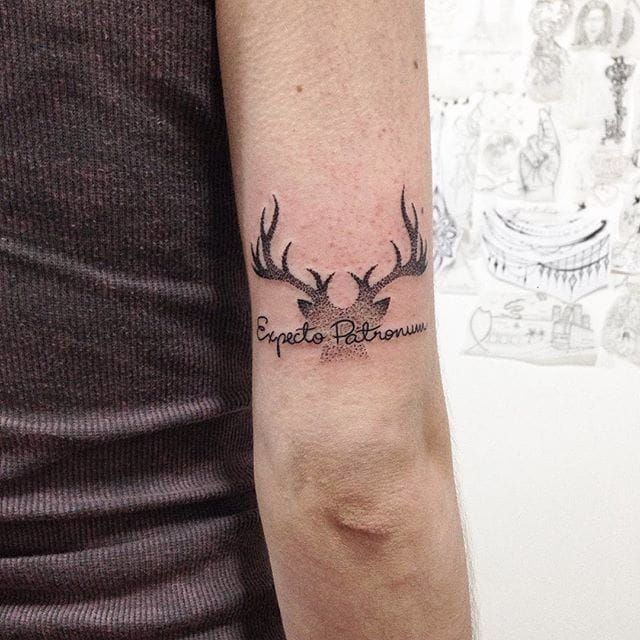 Expecto Patronum dotwork tattoo by Tathi Campos. #harrypotter #hp #popculture #book #film #minimalist #subtle #simple #patronum #spell #dotwork #antlers #tathicampos