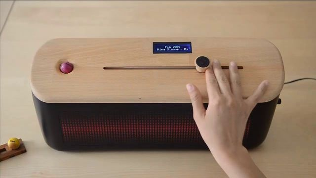 past.fm by Raz Sadeq. past.fm is an audio device that provides users with a tangible timeline of their listening history and other time-based music content.