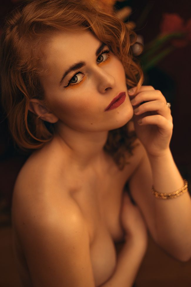 Sensual Portrait of fashionista Christina Key wearing curly, blonde hair and red lipstick