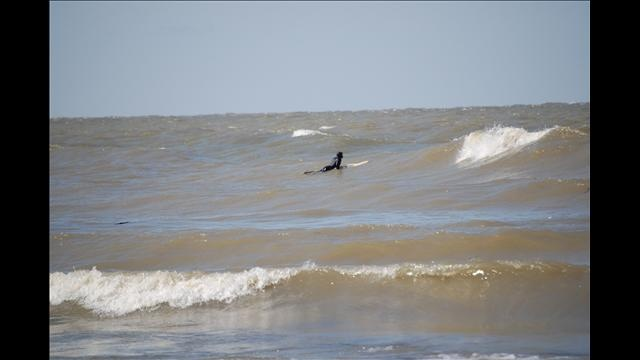 3/26/12 - A #surfer braves frigid winds and waters to catch a wave at #Edgewater Park in #Cleveland.