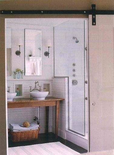 Vessel sinks, table turned vanity, rolling door...