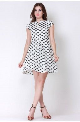 The Monochrome Love Swing Dress is a beautiful piece with hearts printed all over along with the flared hem making it a perfect buy for the season. Team it with strappy heels and get going out to the party.
