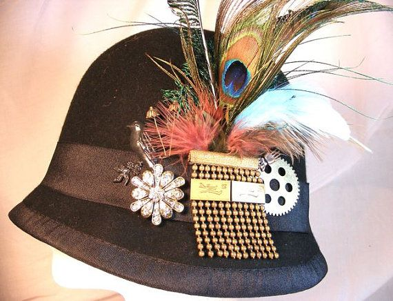 Steampunk Womans Black Wool Felt Cloche Hat with Peacock Feathers, Antique Pin, and Metal Accents