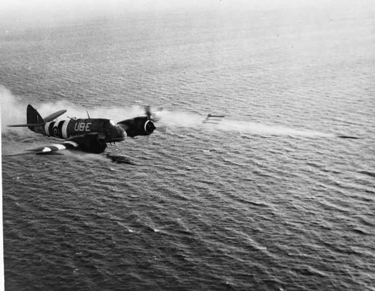 A salvo of eight rocket projectiles being fired over the North Sea by Bristol Beaufighter TF Mark X, NE543 'UB-E', of No. 455 Squadron RAAF based at Langham, Norfolk