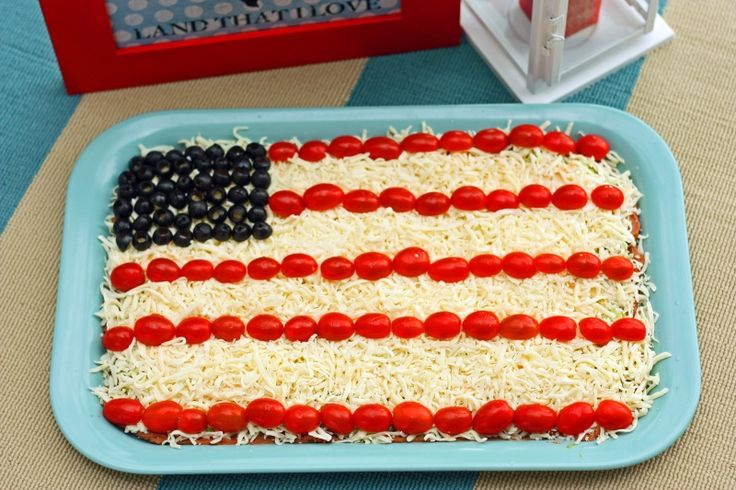 Patriotic Party Dip. This yummy 7 layer dip is the perfect appetizer for your 4th of July party. www.superhealthykids.com
