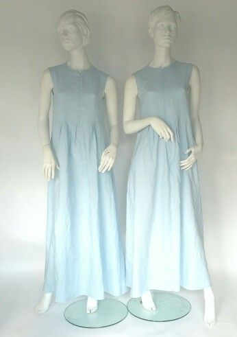 Baby blue sleevless linen dresswith pleats.