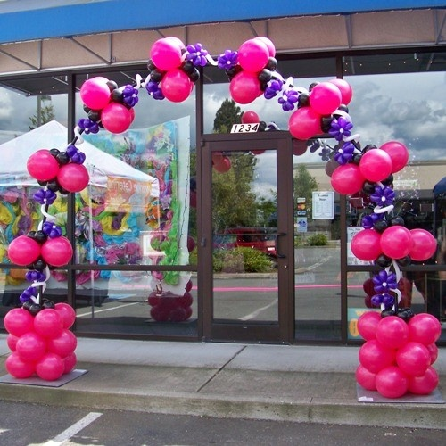 Pink and purple for a hip consignment store open house for Balloon cluster decoration