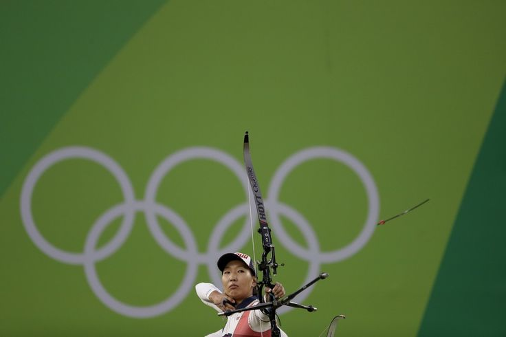 Russia's Inna Stepanova releases her arrow during the women's team archery competition at the Sambadrome venue during the 2016 Summer Olympics in Rio de Janeiro on Sunday. The Russian team won silver.