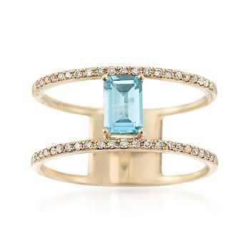 It's no secret. The open space trend is a hit. And now it's more colorful. This ring features a .60 carat emerald-cut blue topaz with .14 ct. t.w. round brilliant-cut diamonds. 14kt yellow gold ring. Free shipping & easy 30-day returns. Fabulous jewelry. Great prices. Since 1952.