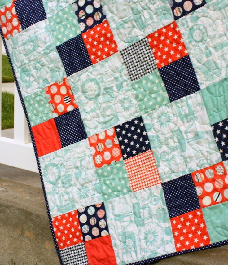 This is one of my favorite go-to quilt patterns for a quick baby quilt. It works really well to show off a main 'focus' print contrasting with a variety of prints in scrappy four-patch blocks.