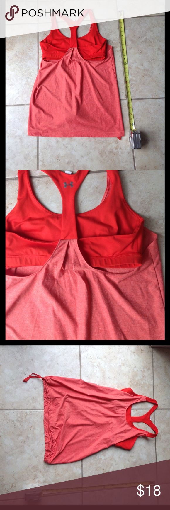 Under Amour top with sports bra Under Amour top with sports bra used tag with size cut off I think it was medium but the bra is tight I says it more of a small Under Armour Tops Tank Tops