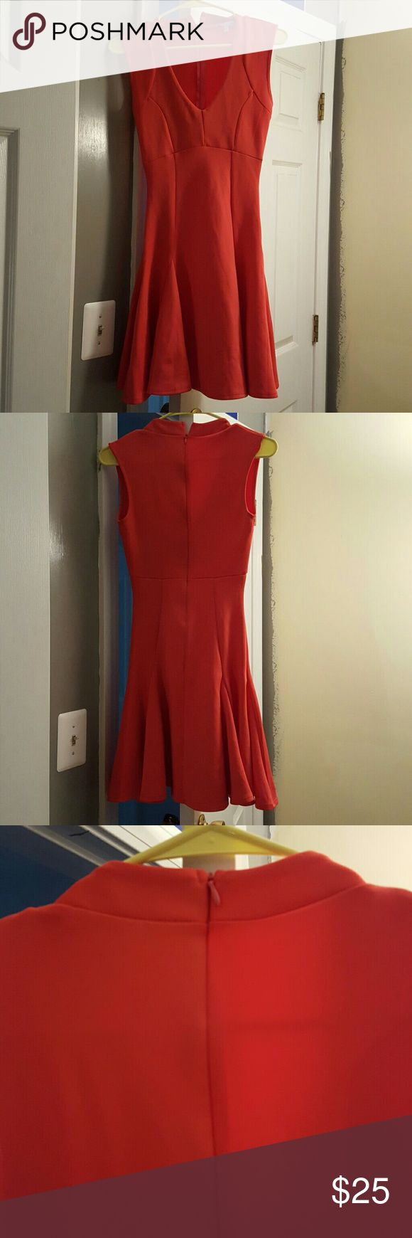 Coral V-neck Dress Worn once, from a smoke free home. Stretchy material with a tight fitting top and a flowy bottom, similar to a skater dress. Zipper is located on the back.  Can be dressed up easily, or can be worn by itself casually. Charlotte Russe Dresses