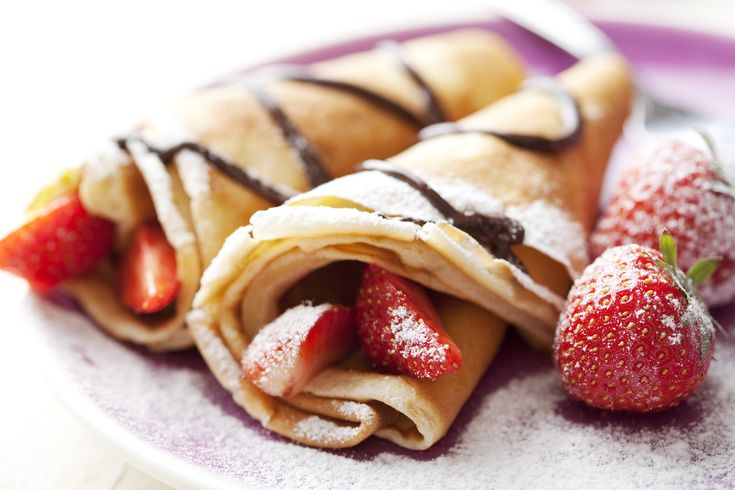 crepes with fruit and chocolate sauce