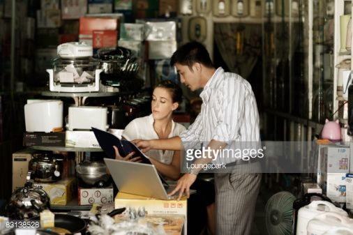 Stock Photo : asian businessman and european small business owne