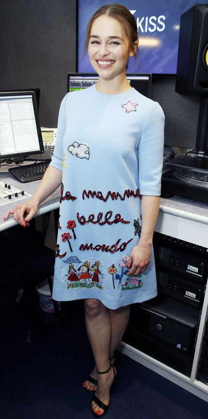 Emilia Clarke was a darling at the Kiss FM Radio studio in a charming sky-blue Dolce & Gabbana shift dress endearingly embroidered with doodles.