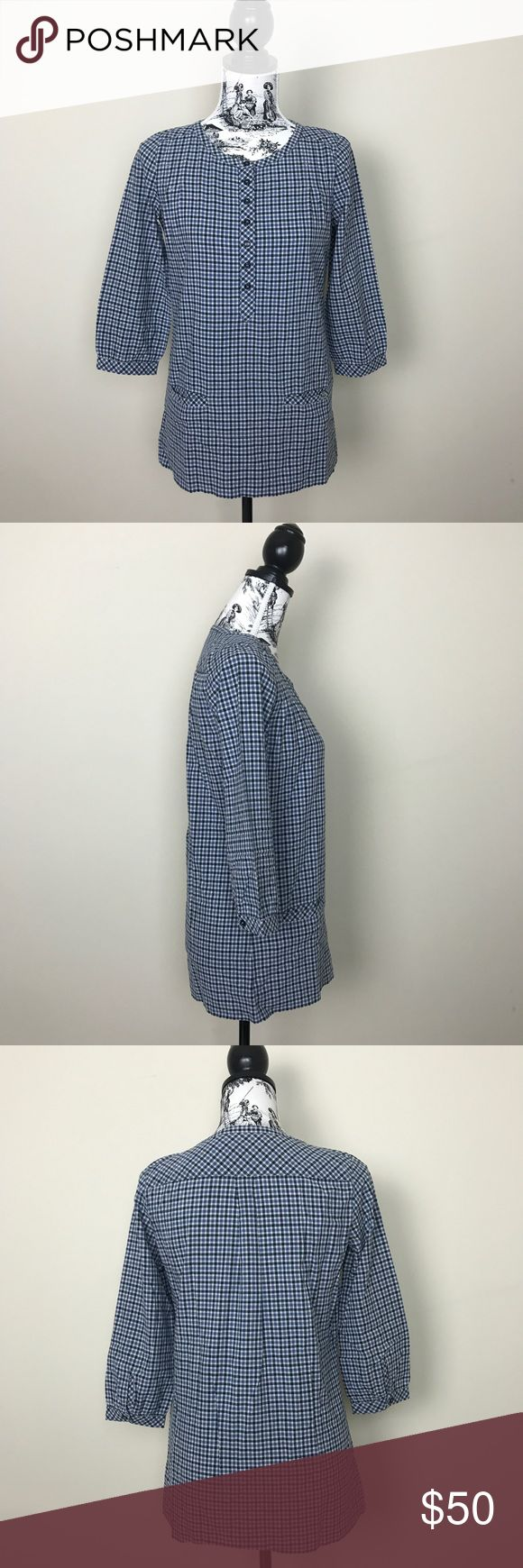 """Lacoste Women's Blue Plaid Tunic Top Lacoste women's blue plaid check tunic top. Buttons down the center. Pull on style. Lower patch pockets. Lacoste alligator embroidered on the right pocket. 3/4 sleeves with button closure. 95% cotton, 5% wool. Length measures 26.5"""" and bust at 17.5"""". Size 36 equivalent to size 4 or small. Lacoste Tops Tunics"""