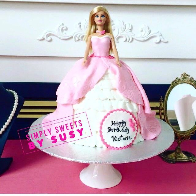 Loving this Barbie cake we made for a special little princess on her first birthday. #barbiecake #birthdaycake #pink #barbie #princess #princessparty #simplysweets