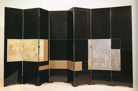 1928_ 'screen' in wood black laquered, silver leaf and composite decoration by eileen gray