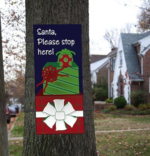 "44"" Outdoor ""Santa Please Stop Here"" Stacked Gift Christmas Tree Wrap Decoration by Evergreen. $44.99. Holiday tree wrap flag features a note to Santa saying ""Please stop here!"" with a trio of presents Dimensions: 44""H x 28""W x .2""DMaterial(s): polyester"
