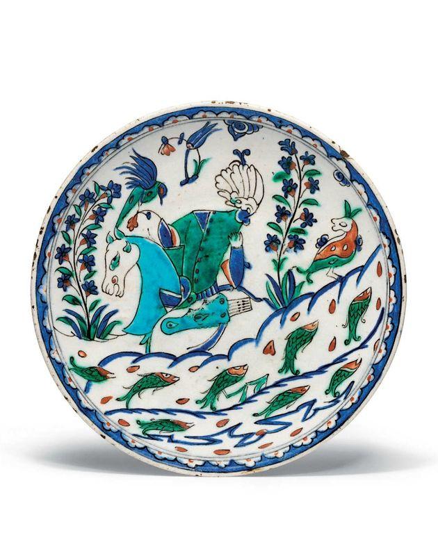 A rare figural rimless Iznik pottery dish, Ottoman Turkey, circa 1570