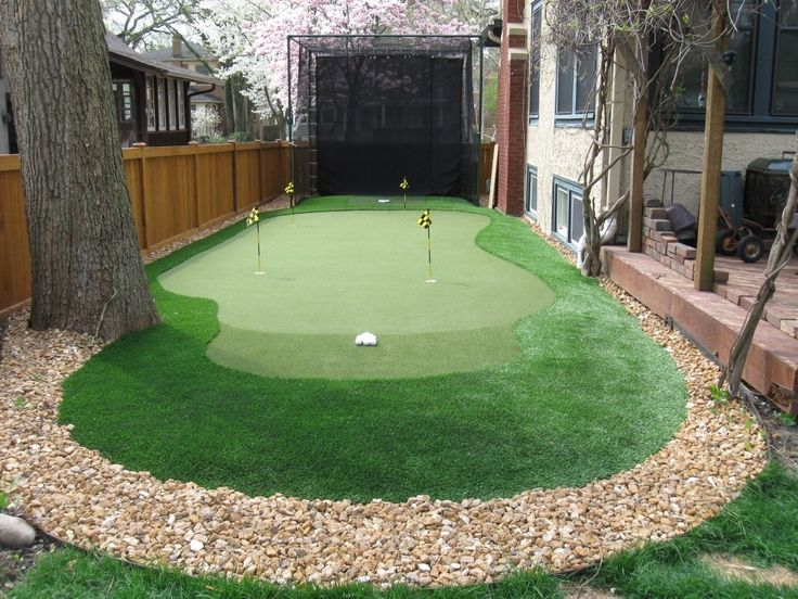 Traditional Landscape/Yard with Backyard Golf Cage, Fence, Dave Pelz GreenMaker Putting Green System