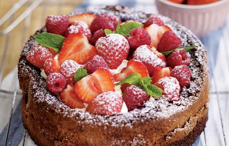 Gluten-free chocolate cake with strawberries and raspberries