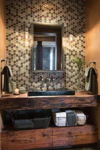 Different take on a bathroom ... Back wall tiled and love the vanity. Missing hidden storage tho
