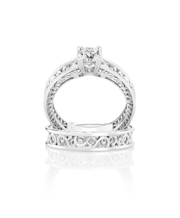 Love the detail in this engagement ring with matching wedding band