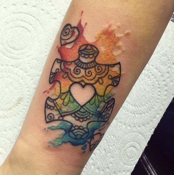 fa9299bc25fbf We love the henna designs within the puzzle piece, and the incredible  splashes of watercolor. #autismawareness   Autism Awareness   Autism tattoos,  ...