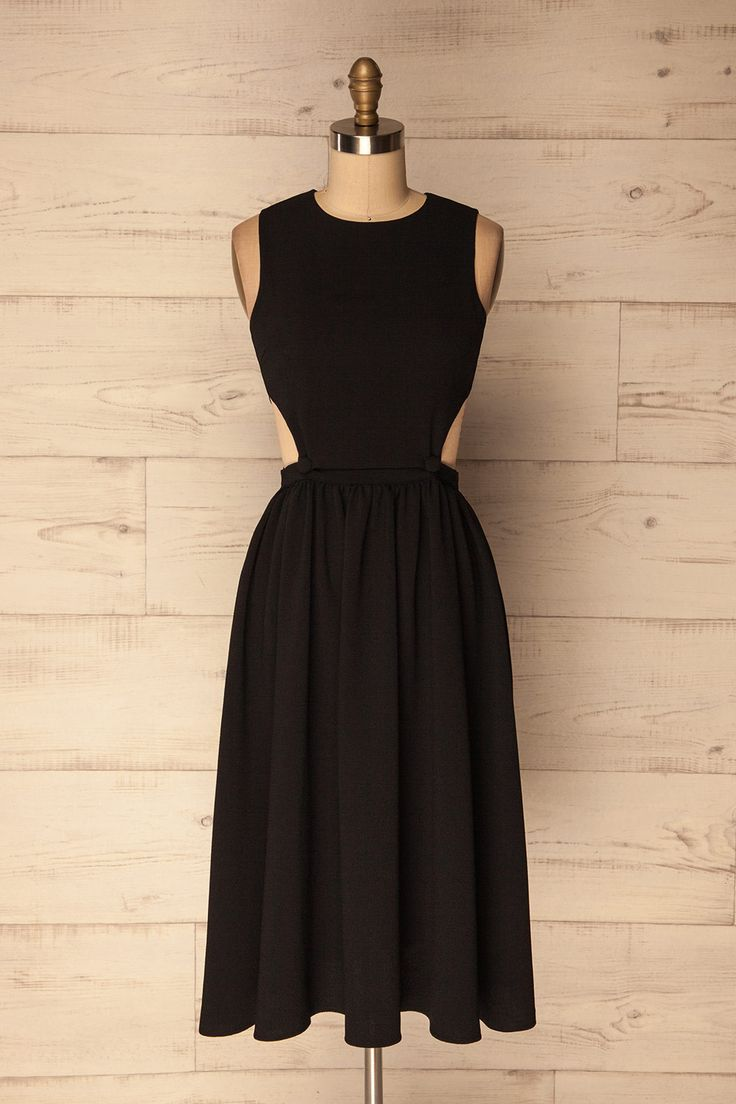 Davagna #boutique1861 / This sleeveless little black dress  has a full skirt that falls just below the knee.  Little cut-outs at the waist are fastened together with two buttons, meaning you can alter how much skin you want to show off.  A romantic, yet edgy take on the little black dress, it's perfect for all occasions.