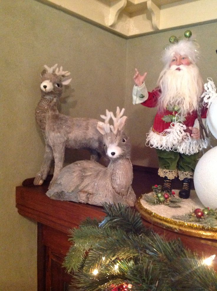 Christmas at ELMS-HAVEN. Reindeer on the mantle piece in the lounge room.