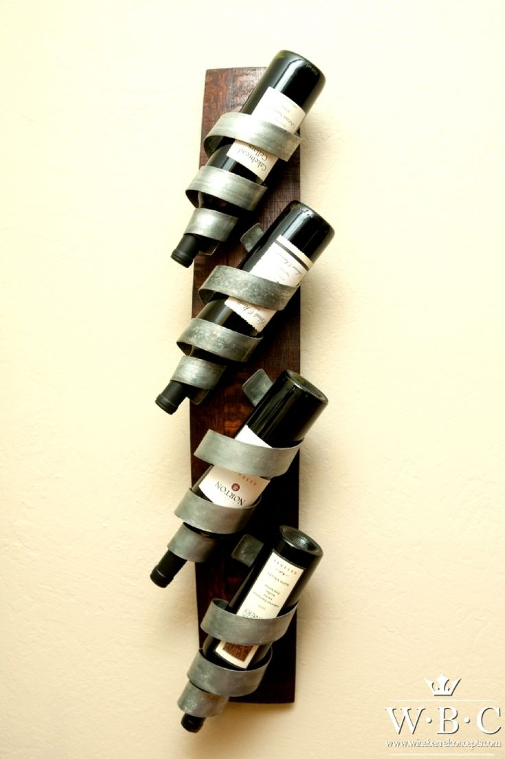 Chris's Curls Wall-Mounted Wine Rack  ¦ Wine Barrel Concepts. 4-bottle wine rack that can be hung either vertically or horizontally. The base of the rack is made from an oak wine barrel stave which is sanded and stained by hand.