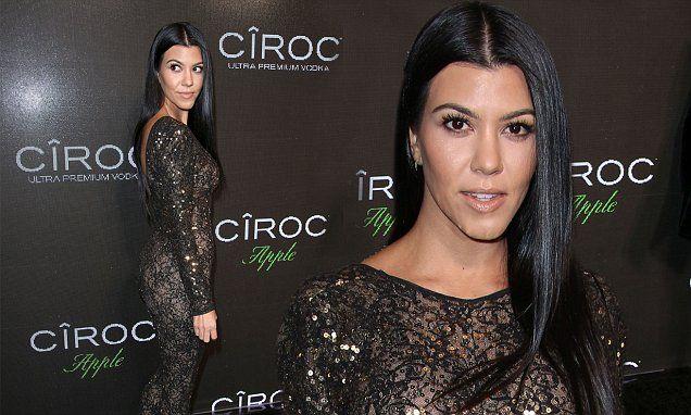 Kourtney Kardashian wows in sheer black lace bodysuit