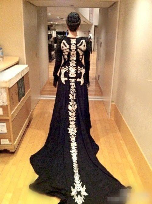 Costume idea for Halloween ball. Black dress adorned with skeleton, shoulder blades, spine, pelvis and fantastic dragon like tail.