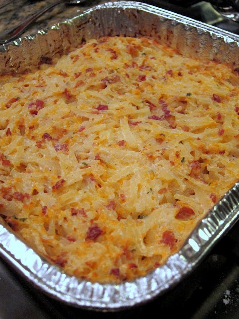 2 (16oz) containers sour cream 2 cups cheddar cheese, shredded 2 (3oz) bags real bacon bits 2 packages Ranch Dip mix 1 large (28 - 30oz) bag frozen hash brown potatoes - shredded kind Combine first 4 ingredients, mix in hash browns. Spread into a 9x13 pan. Bake at 400 for 45-60 minutes.