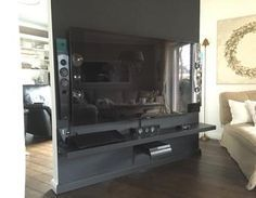 Projects »DIY Rotating TV wall as partition! Great idea for your living room.