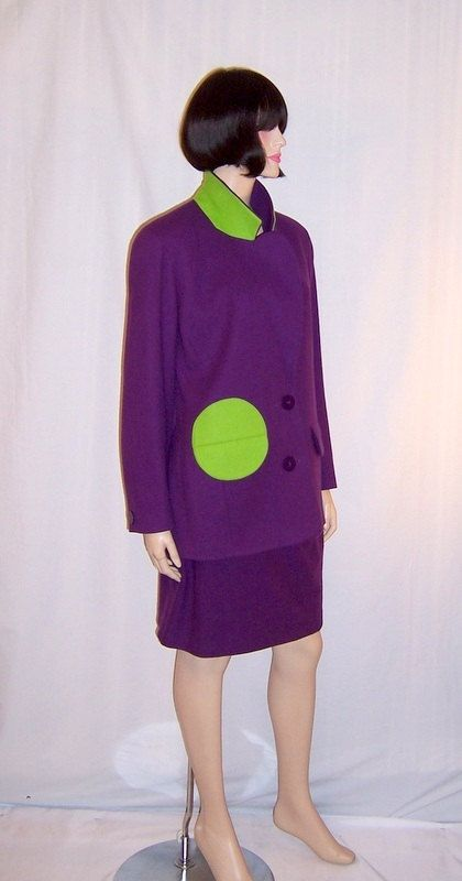 This is a snappy, classic, wearable suit designed by Arabella Pollen of violet wool trimmed with witty and unexpected touches of chartreuse at the right pocket area and at the collars backing. Arabella Pollen had established a reputation as being the bold colorist of British fashion and in the 1990s was at the top of her game. Diana, the Late Princess of Wales, was one of Pollens first customers. Pollens look was easily identifiable. Her clothes were chic, elegant, innovative, but not too…