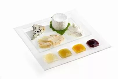 Plate of cheeses with Lazzaris sweet-spicy sauces