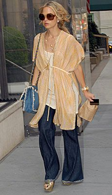 Rachael Zoe... This woman could wear a trash bag and a piece of Chanel jewelry and look fabulous!