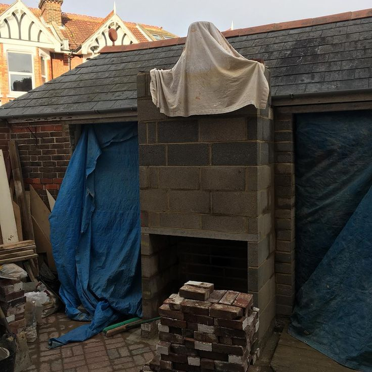 Southsea Courtyard garden starts taking shape with a feature fireplace and a matching pair of French doors into the old garage which is now a garden room. #landscaping #gardens #gardendesign #gardendecor #gardendesigner #hampshire #hampshirelife #southsea #southcoast #southampton #newforest #chichester #portsmouth #portsmouthnh #lovesouthsea #winchester #moderngarden