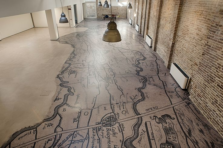 The floor of the ancient archive of Consorzio di Bonifica della Romagna Occidentale has been custom-made by Inkiostro Bianco. It deals with a special project that has been realized through the scan capture of the hi-resolution image of the old water reservoir map that has been finally printed on EQ.Dekor glass fiber.