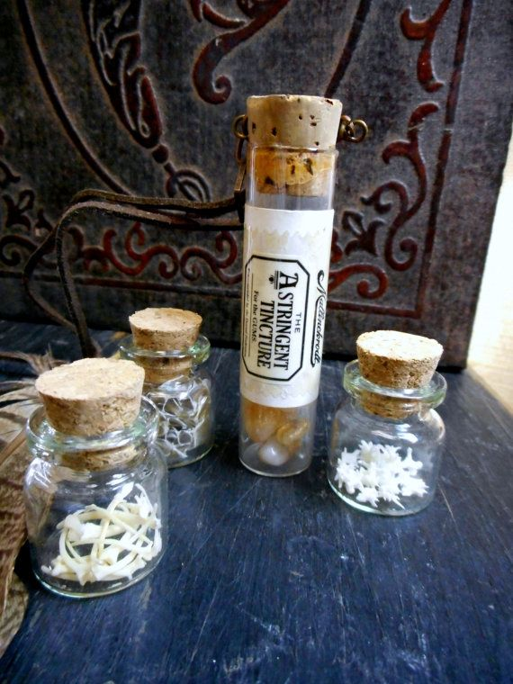 The Apothecary Shoppe.  Antique Glass Astringent Tincture Pharmacy vial with golden Citrine nuggets.