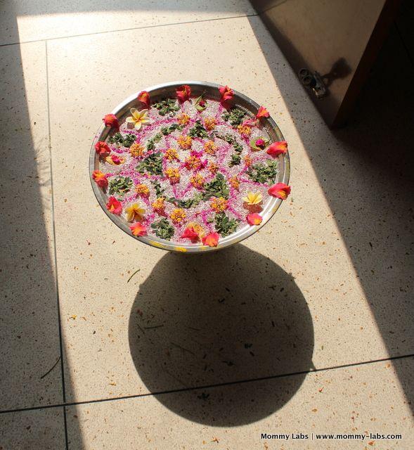 floating flower rangoli light shadow photography